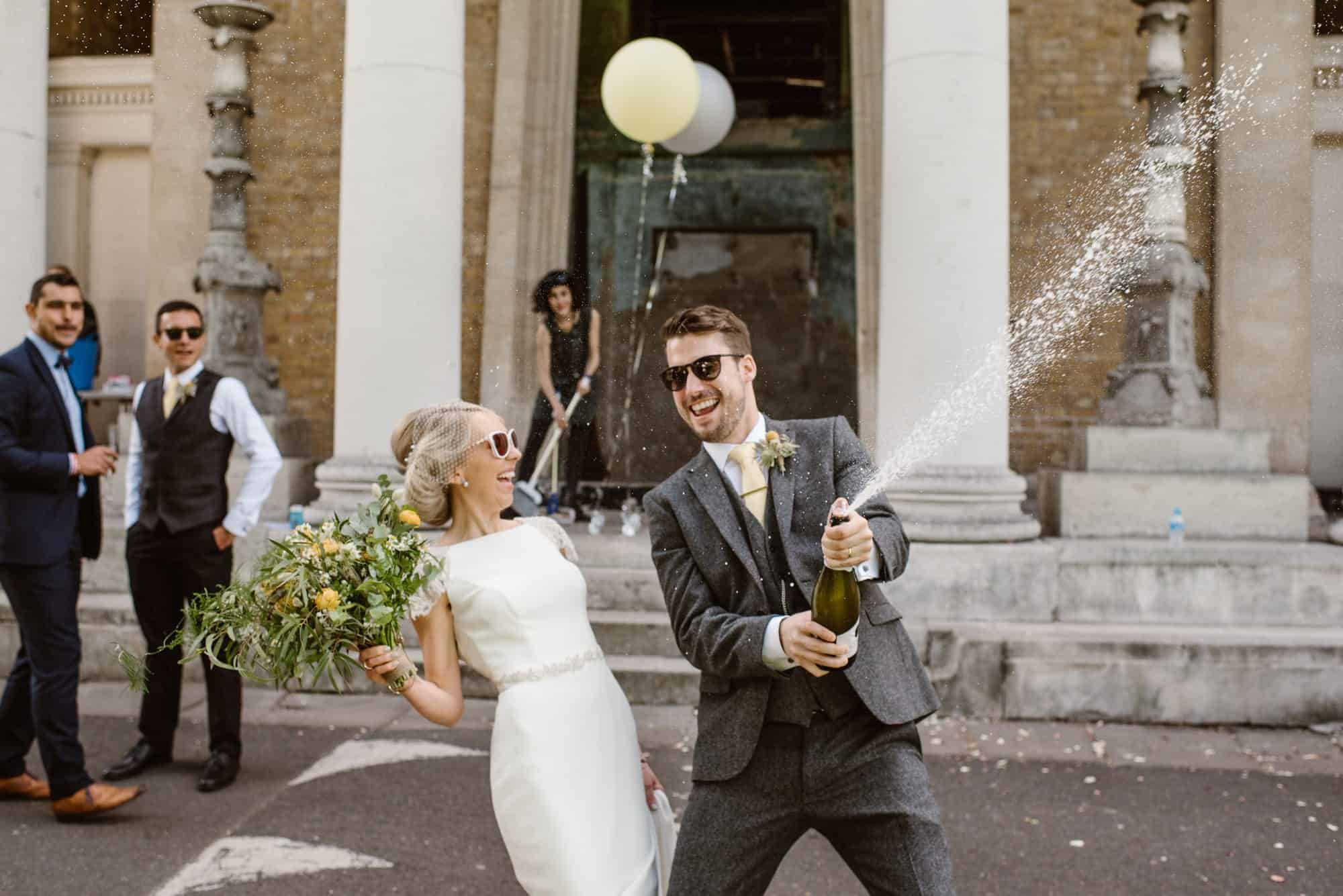 Lucy & Tom celebrating after their wedding ceremony.